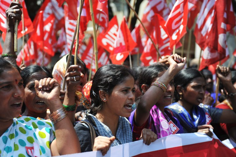 Indian workers rally during a two-day strike called by trade unions opposing the government's economic policies in Hyderabad on February 20, 2013.
