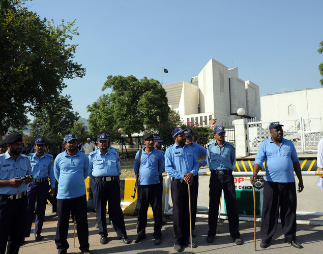 Pakistani police are deployed outside the Supreme Court building following the verdict against Pakistan's Prime Minister Yousuf Raza Gilani out side the Supreme Court in Islamabad.