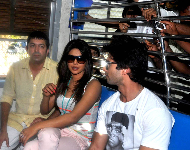Bollywood director Kunal Kohli (L), actress Priyanka Chopra (C), and actor Shahid Kapoor (R) travel in a local train during a promotional event for the forthcoming Hindi film 'Teri Meri Kahaani' in Mumbai.