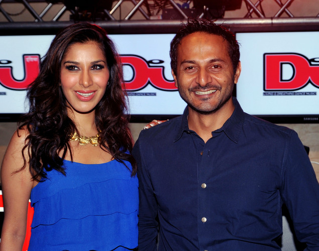 Indian actress and Sophie Choudhry (L) poses for a photograph with radio and video deejay Nikhil Chinappa during the DJ Mag launch event in Mumbai.