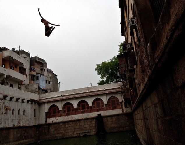 An Indian boy jumps into a baoli or step-well at the Nizamuddin Dargah in New Delhi.