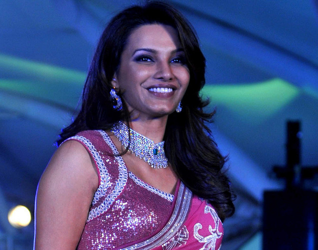 Bollywood film actress Diana Hayden walks the ramp during the seventh annual Pidilite-CPAA Charity Fashion Show showcasing designers Manish Malhotra and Shaina NC in support of the Cancer Patients Aid Association.
