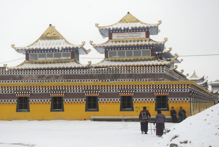 Tibetan pilgrims are pictured on March 11, 2012 outside Kirti monastery in Aba county, Sichuan province.