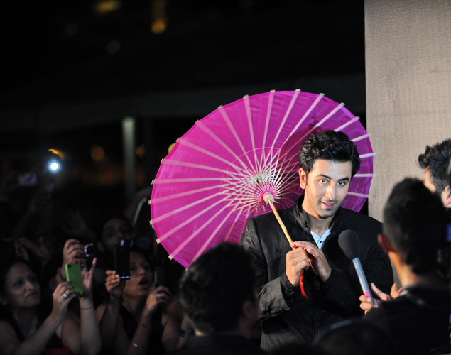 Bollywood actor Ranbir Kapoor holsd an umbrella during the International Indian Film Academy (IIFA) awards in Singapore.