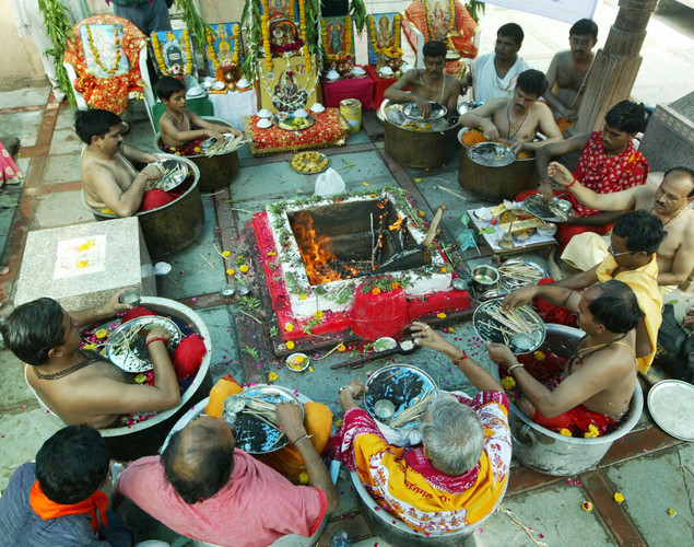 Individuals perform a 'Parjanya Yagna' to appease the Rain Gods at Shree Bahucharji Temple in Ahmedabad.
