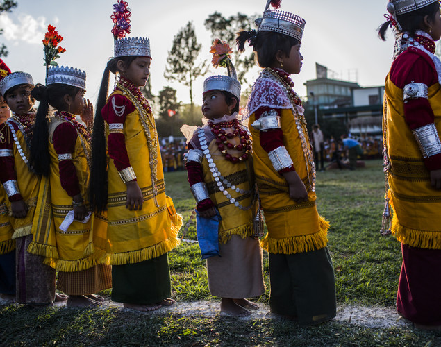 Tribal Khasi maidens and young men dressed in traditional costume participate in dance during the Shad Suk Mynsiem Festival.