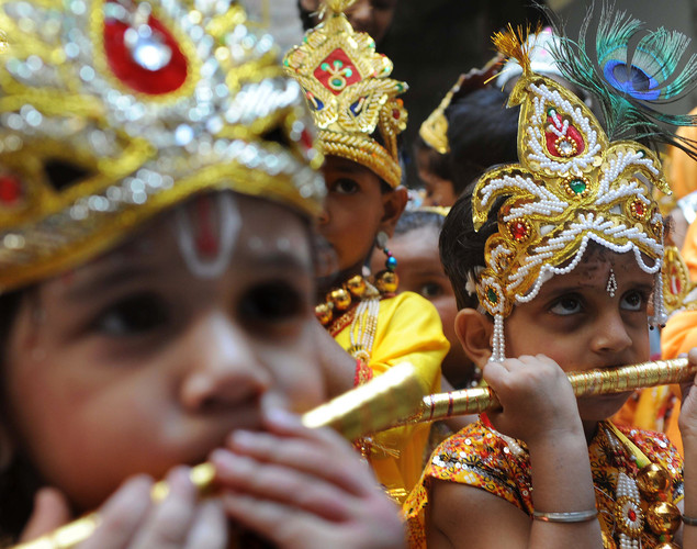 Indian schoolchildren dressed as Hindu God Lord Krishna pose at a school in Amritsar on August 9, 2012 on the eve of the 'Janmashtami' festival.