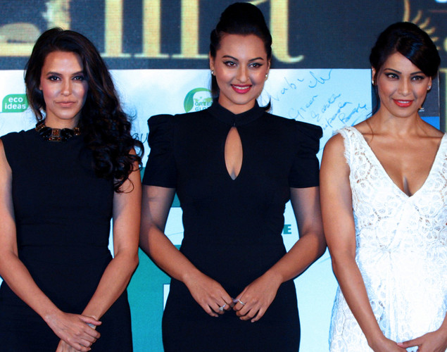 Neha Dhupia,(L),  Sonakshi Sinha (C) and Bipasha Basu attend the press conference for the announcement of the 'IIFA Awards 2012' ceremony in Mumbai.