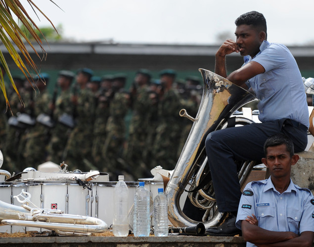 Sri Lankan Air Force personnel rest during a parade rehearsal break in Colombo.