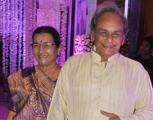 Bollywood music composer Anandji with wife attend the wedding reception of playback singer Sunidhi Chauhan and musician Hitesh Sonik.