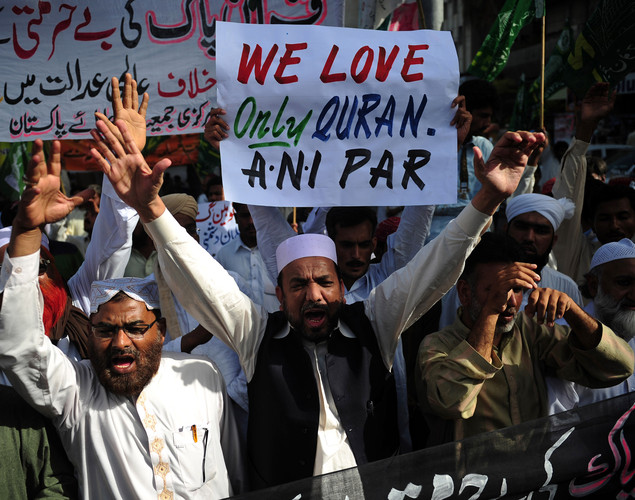 Pakistani Islamists carry placards during a protest against US pastor Terry Jones, over the recent burning of the Koran by Jones at his Florida church, in Karachi.