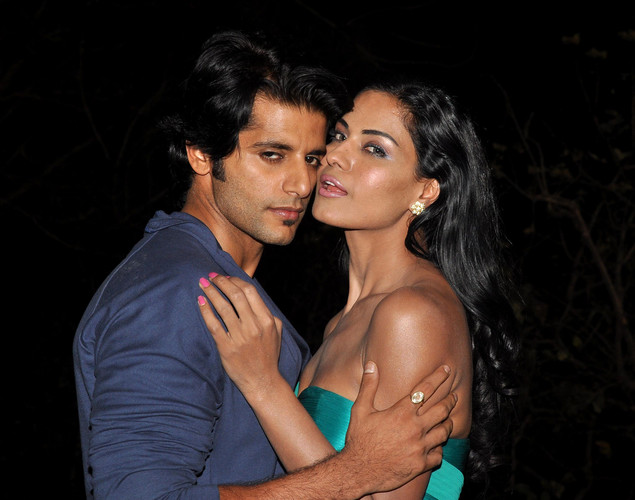 "Pakistani actress Veena Malik (R) and Bollywood actor Karanvir Bohra (L) pose on the set of their forthcoming Hindi film ""Mumbai 125 kms"" in Mumbai on March 21, 2012."