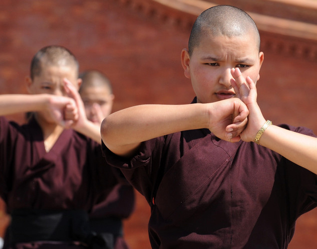 Buddhist nuns practice Kung-fu at the Amitabha Drukpa Nunnery on the outskirts of Kathmandu