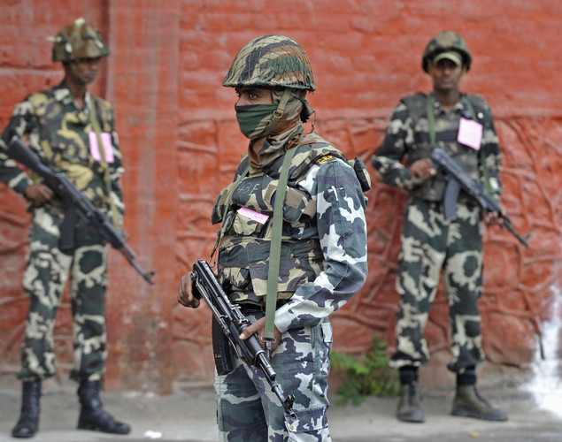 Indian Central Reserve Police Force (CRPF) stand guard during a one day strike on India's 66th Independence Day in Srinagar on August 15, 2012.