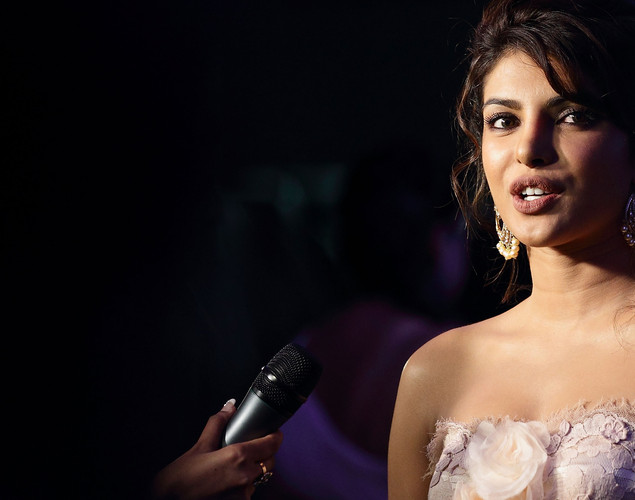 Bollywood actress Priyanka Chopra speaks to the media at the IIFA green carpet event at the 2012 International India Film Academy Awards at the Singapore Indoor Stadium.