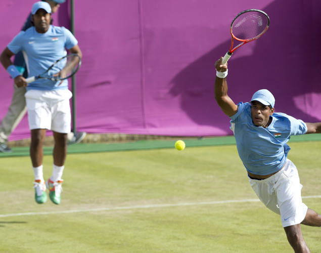 Leander Paes of India (L) watches as partner Vishnu Vardhan plays a rteturn during their men's first round doubles match against Netherland's Robin Haase and Jean-Julien Rojer for The 2012 London Olympic Games at the All England Tennis Club in Wimbledon, southwest London, on July 30, 2012