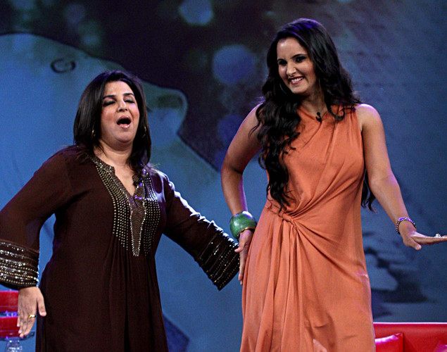 "Indian tennis player Sania Mirza (R) interacts with choreographer Farah Khan on the set of NDTV's television show ""Issi Ka Naam Zindagi"" in Mumbai."