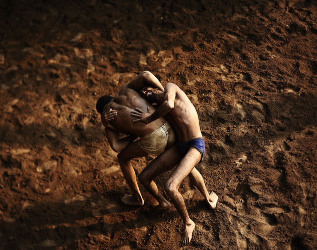 Indian wrestlers aim to develop muscle, flexibility and strength in their training.