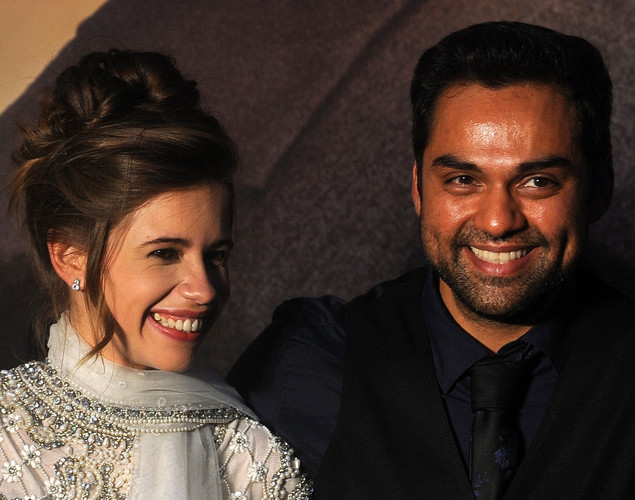 Bollywood actress Kalki Koechlin (L) and actor Abhay Deol pose for the media after arriving at the green carpet to attend the premier of their new movie 'Shanghai' during the International Indian Film Academy (IIFA) awards event, in Singapore.