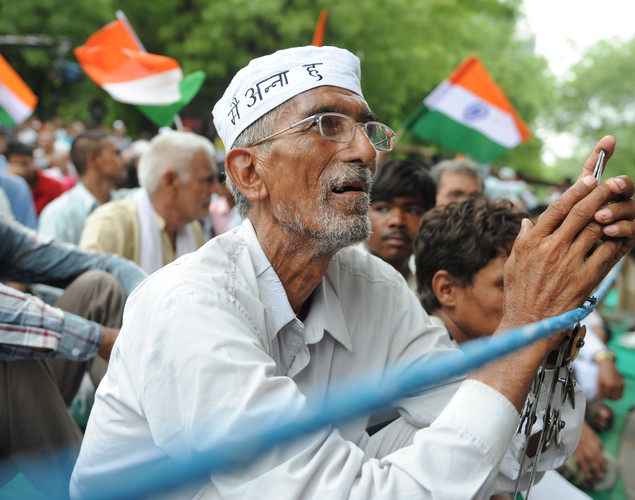 An Indian supporter of anti-corruption activist Anna Hazare looks on during a protest in New Delhi.