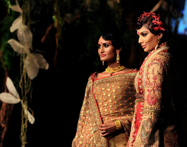 Indian models showcase creations by Indian designer Tarun Tahiliani on the opening day of Aamby Valley India Bridal Fashion Week 2012 in Mumbai.