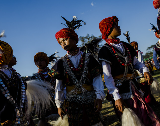 Tribal Khasi men dressed in traditional costume participate in a traditional dance during the Shad Suk Mynsiem Festival.