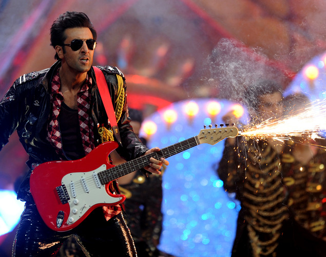 Bollywood actor Ranbir Kapoor (L) performs on the stage during the International Indian Film Academy (IIFA) awards ceremony in Singapore.