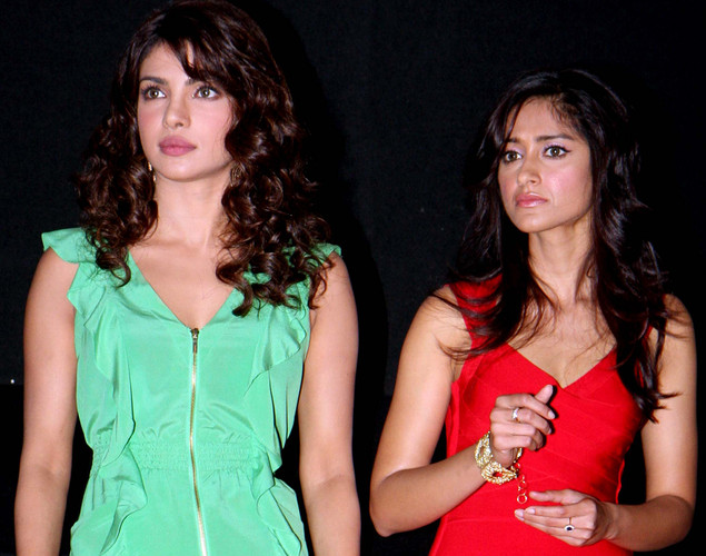 Bollywood actress Priyanka Chopra (L) and  Ileana D'Cruz (R) arrive for the launch of the upcoming Hindi film, Barfi.