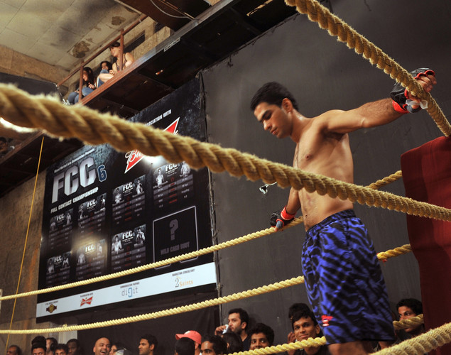 Indian student, judo practitioner and mixed martial arts (MMA) fighter Aditya Despande, 21, concentrates before the start of his bout during the FCC (Full Contact Championship) 6 fight night in Mumbai.