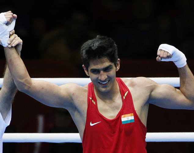 Vijender of India celebrates his 14-10 points decision victory over Danabek Suzhanov of Kazakhstan in their first round Middleweight (75Kg) bout of the 2012 London Olympic Games on July 28, 201 2 at the ExCel Arena in London.