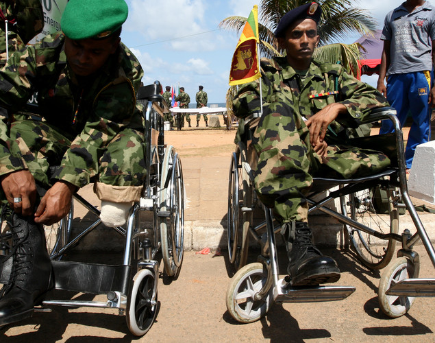 A disabled Sri Lankan Army officer prepares his boot during military parade rehearsals in preparation for the celebration of the third anniversary of the end of the civil war and the defeat of the separatist Tamil Tiger rebels.