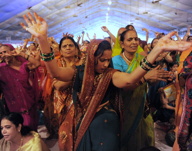Supporters dance during a religious function organized by Indian yoga Guru Baba Ramdev (unseen) in Ahmedabad.