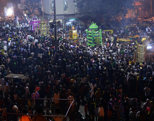 Indian Muslim devotees prays as they walk along with Tazias to mark Ashura in Ahmedabad.