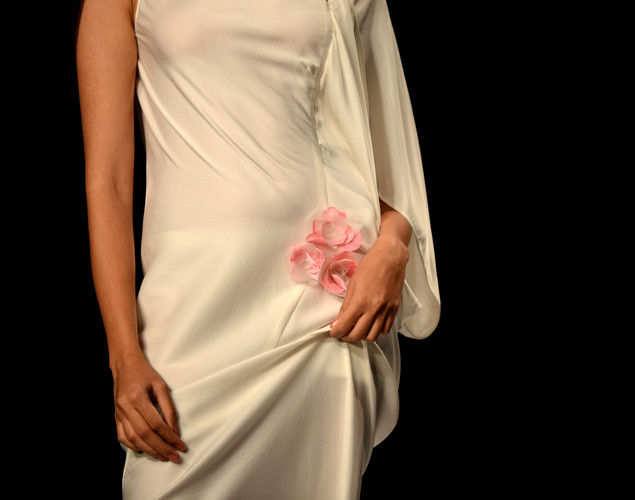 A model presents a creation by Indian designer James Ferreria during the second day of the Wills India Fashion Week Spring- Summer collection 2013 in New Delhi.