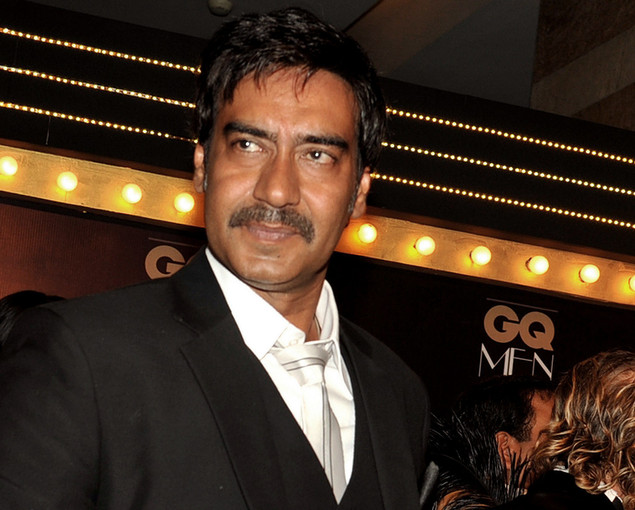 Indian Bollywood film actor Ajay Devgn holds his Cinematic Icon award during the 'GQ Men of the Year Awards 2012' in Mumbai.