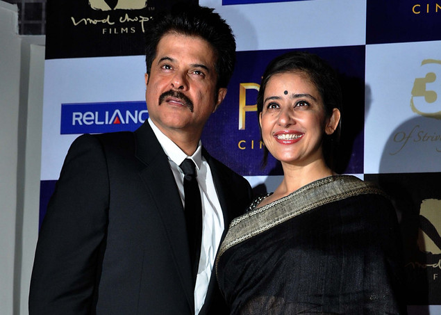 Anil Kapoor (L) poses with Manisha Koirala as they attend the Indian Bollywood producer-director Vidhu Vinod Chopra's films celebratation ?30 years of Striving in Cinema?  film festival premier