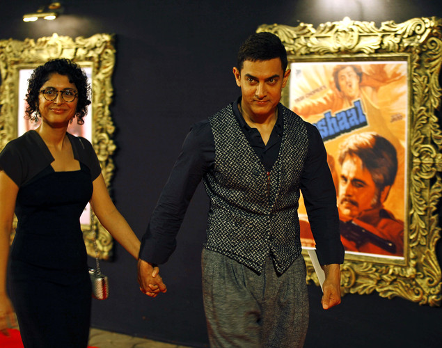 "Bollywood star Aamir Khan arrives with his wife Kiran Rao to attend the premiere of the film ""Jab Tak Hai Jaan"" or ""As Long As I Am Alive"" in Mumbai, India."