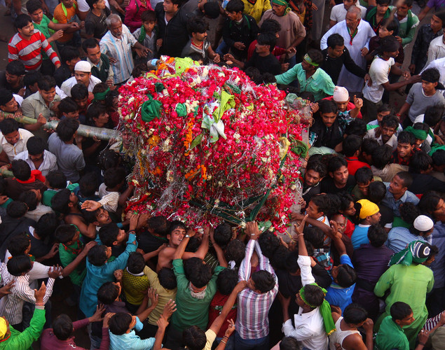 Indian Shiite Muslims take out a Tajiya or tableau during a religious procession on the tenth day of Ashura in Allahabad.