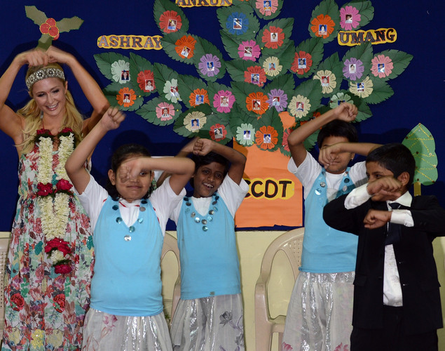 Paris Hilton dances with children during a visit to an orphanage in Mumbai.
