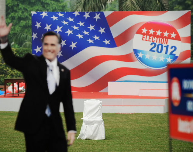 An empty seat is left behind next to an empty stage and a cutout of US Presidential candidate Mitt Romney after a US embassy election party at a local hotel in Delhi.
