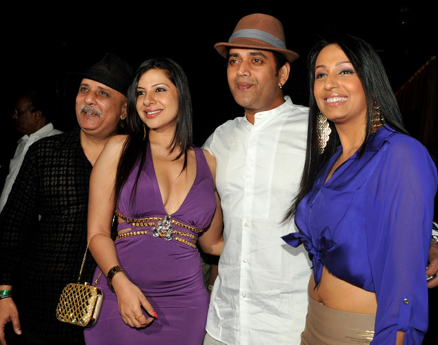 Indian Bollywood actors Kashmira Shah, (R), Ravi Kishan (2R) and Rajesh Puri (L) attend the '12.12.12' birthday celebration of dancer and actress Sambhavna Seth (2L) in Mumbai.