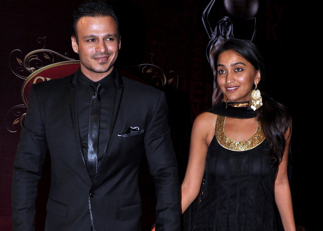 Indian Bollywood actor Vivek Oberoi (L) with his wife Priyanka attend the 'Global Indian Film and TV Honors Awards 2012.'
