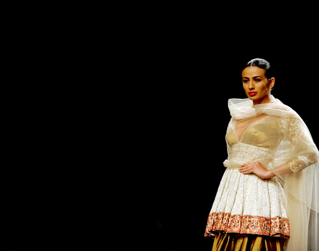 A model presents a creation by Indian designer Manish Malhotra during the second day of the Wills India Fashion Week Spring- Summer collection 2013 in New Delhi.