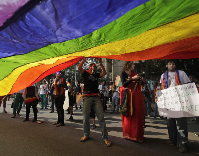 Participants carry a nearly 50-foot-long, rainbow-colored banner at the 5th Delhi Queer Pride parade in New Delhi, India.