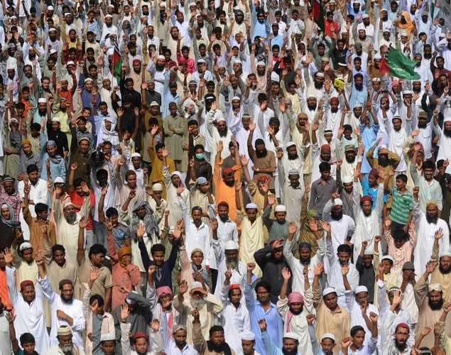 Activists of Sipah-e-Sahaba Pakistan shout slogans as they gather at the funeral ceremony of a protestor who was killed during a demonstration against a US-made anti-Islam film, in Karachi.