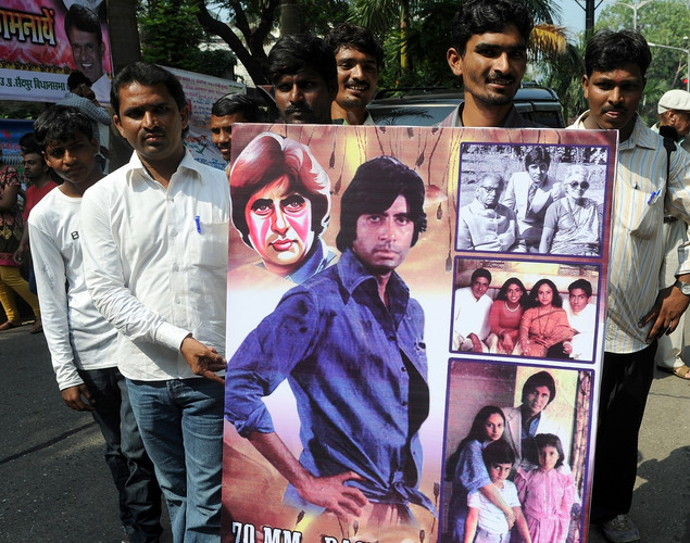 Indian fans of Bollywood star Amitabh Bachchan gather outside his residence on his 70th birthday in Mumbai.