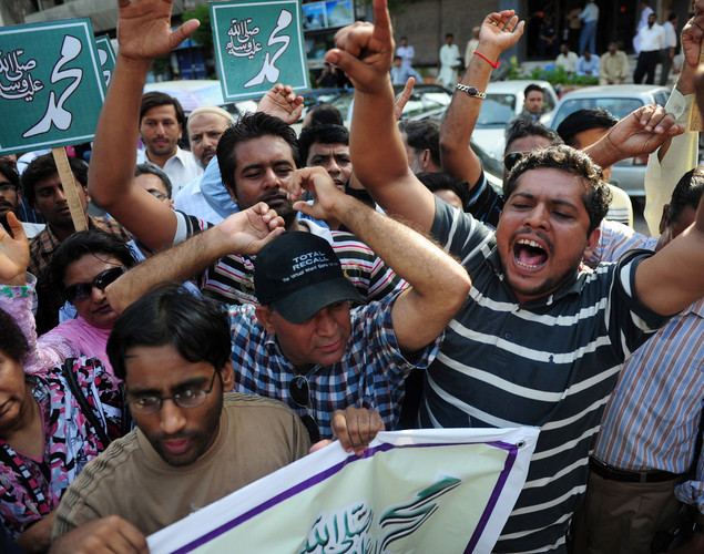 Pakistani journalists shout slogans during a protest against an anti-Islam film in Karachi.