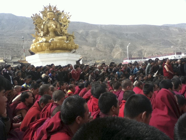In this Wednesday, March 14, 2012 photo released by Freetibet.org, Tibetan monks gather in protest after the latest self-immolation attempt in Tongren, a monastery town in Qinghai province, western China.