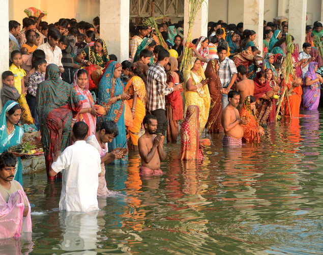 Indian Hindu devotees pay homage during Chhat Puja while standing in the sarover - water tank - of the Durgiana temple in Amritsar.