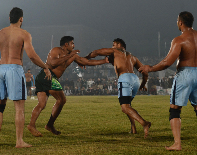 A Pakistani kabbadi player (2L) attempts to tag his Indian opponents during the Kabaddi Asia Cup final match in Lahore. Pakistan won the 2012 Kabaddi Asia Cup final match against India.
